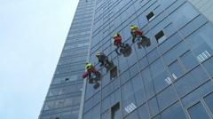 Industrial Climbers. Window washer on a skyscraper. Stock Footage