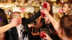 Thirteen happy people clink glasses with cocktails at party Stock Footage