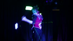Performance of man in samurai garb with glow sticks Stock Footage