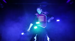 Performance of man in samurai garb with glow sticks in smoke - stock footage