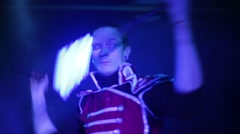 Performance of man in samurai costume with glow sticks Stock Footage