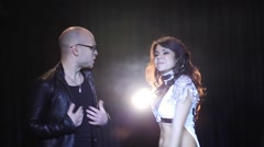 Dancing pretty woman and singing bald man among smoke Stock Footage