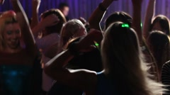 Ten young happy women in sexy clothes dance in night club - stock footage