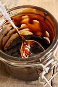 Treacle or  Molasses - stock photo