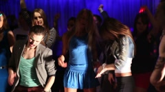 Twelve people in sexy clothes rest and dance in night club - stock footage