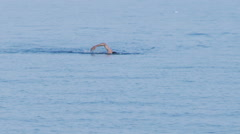 Lone swimmer in the peaceful waters of the mediterranean sea. Stock Footage