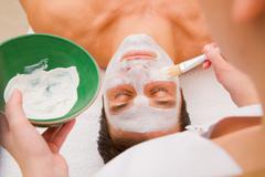 facial beauty treatment by an aesthetician - stock photo