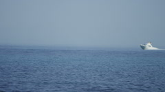 boat travelling at speed across the mediterranean sea - stock footage