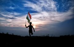 Boy running with indian flag Stock Photos
