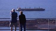 Stock Video Footage of watching log ship depart in  4k