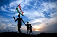 Stock Photo of boys running with indian flag
