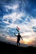Man jumping with indian flag Stock Photos