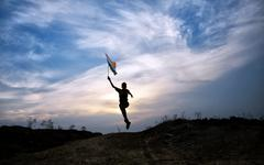 boy running with indian flag - stock photo