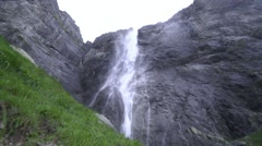 Big waterfall falls from high cliffs Stock Footage