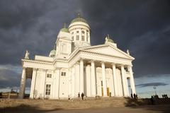 people leaving helsinki cathedral in the evening after concert - stock photo