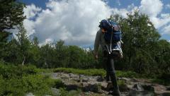Hiker walking a trail Stock Footage