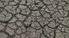 Camera tilts upwards on drought cracked ground - stock footage