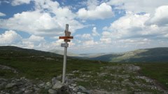 Crossroad sign for hikers and trekkes in the Norwegian mountains Stock Footage