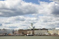 harbor front and helsinki cathedral seen from the water - stock photo