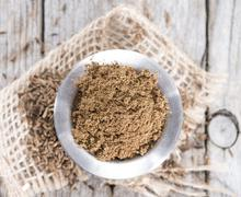 Caraway powder in a bowl Stock Photos