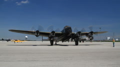 Avro Lancaster bomber with running four Merlin Engines is waiting on start line Stock Footage