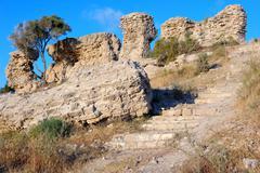 Remains of ancient walls - stock photo