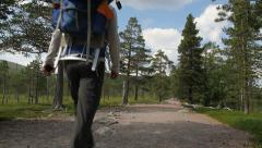 Man walking on a trail Stock Footage