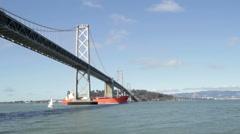 San Francisco Bay Bridge with cargo ship - stock footage
