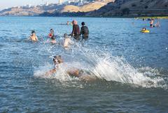 Swimming in lake Kinneret - stock photo