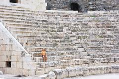 The woman in the ancient Roman amphitheater - stock photo