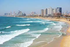 Sea coast and the view of Tel Aviv at the evening - stock photo