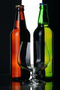 Bottles of beer from green and brown glass, isolated. - stock photo