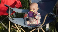 Camping baby with sippy cup Stock Footage