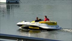 SeaDoo Sport boat with father and son Stock Footage