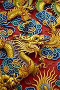Golden dragon statue in chinese temple in Chonburi province Thai Stock Photos