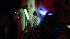 Close up of girl with glow stick bracelet Stock Footage
