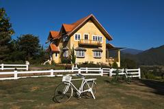 Yellow classic house on hill in pai district Stock Photos