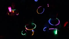 Group of people wave glow sticks Stock Footage