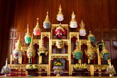 Khon Masks is situated on the set of altar table - stock photo