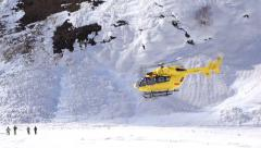 Air ambulance performs a mountain rescue mission Stock Footage
