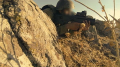 armed soldiers walking through field. soldiers running with Machine gun weapons. - stock footage