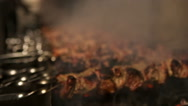 Large number of barbecue cooked on fire Stock Footage