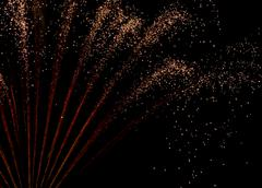 Exploding red and white fireworks spray, close-up - stock photo