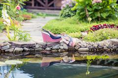 marine sandals lie beside the pool - stock photo
