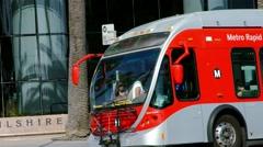 4K, UHD, Passengers boarding bus on Wilshire Boulevard in Los Angeles Stock Footage