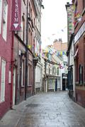 view down quaint cobbled grape lane, whitby - stock photo