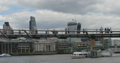 Pedstrians cross the Millennium Bridge in London 4K Stock Footage