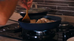 Two pan on the fire, chicken fried Stock Footage