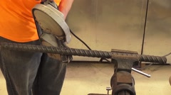 Stock Video Footage of Rebar is cut with a saw - Active Construction Site Footage