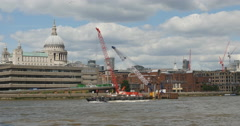 River craft on Thames passes St Pauls, London 4K Stock Footage